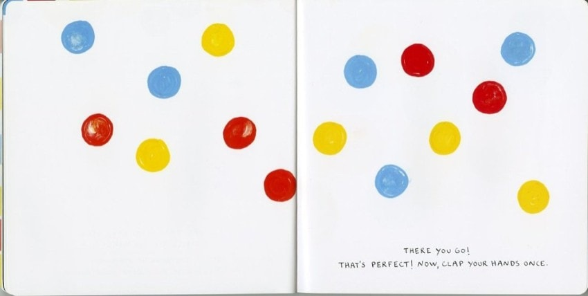 """A spread from Herve Tullet's """"Press Here,"""" a book that rewards the reader for interacting with its page."""